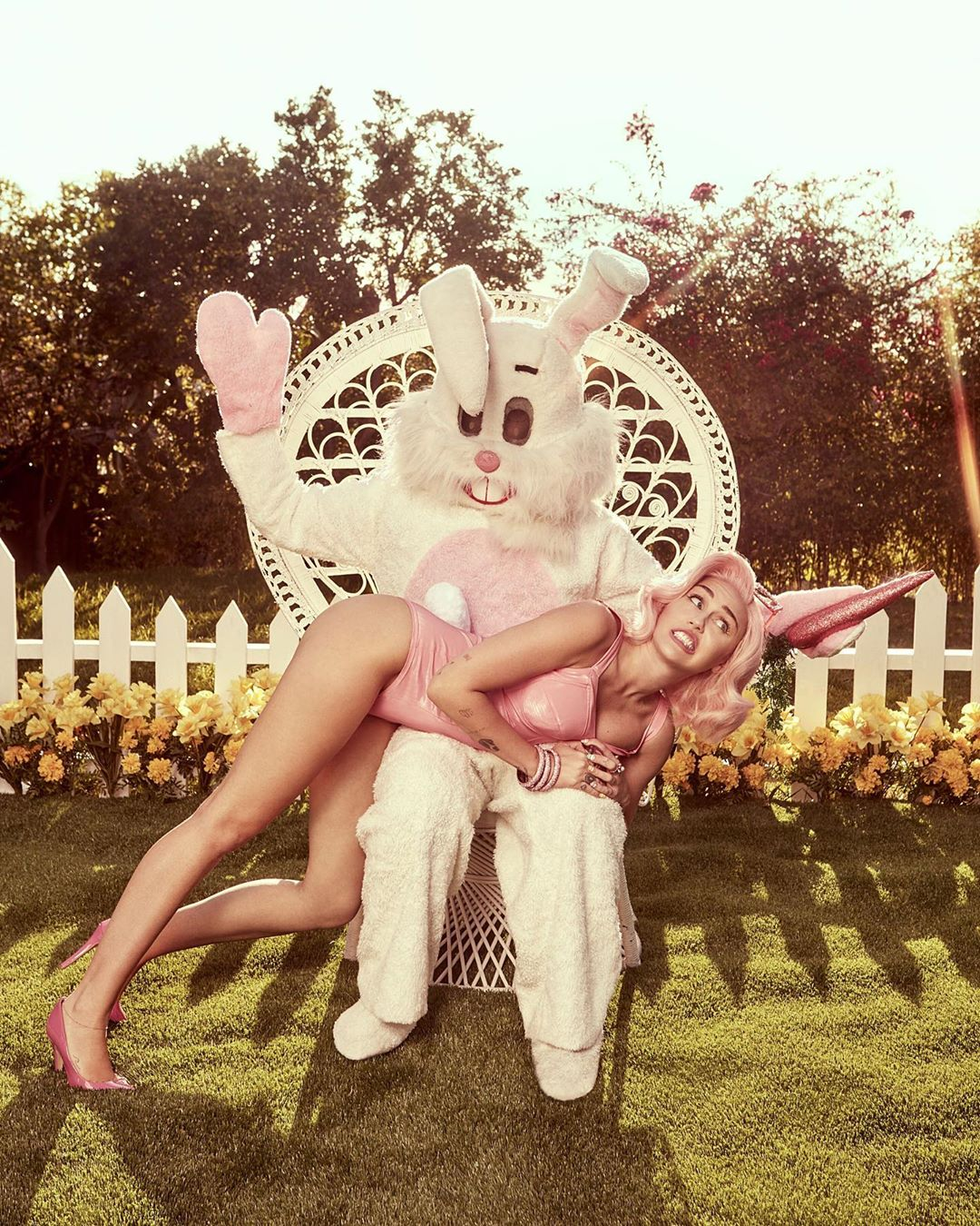 Rita ora dresses as a sexy easter bunny as she eats chocolate eggs in her knickers